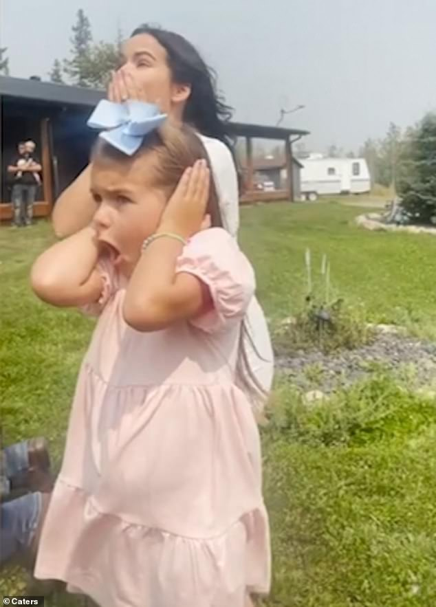 The six-year-old girl, pictured, jumped into her mother's arms moments after receiving the news