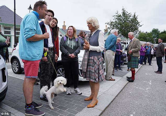 Doggos everywhere! Camilla also chatted to a local man with a fluffy white pooch