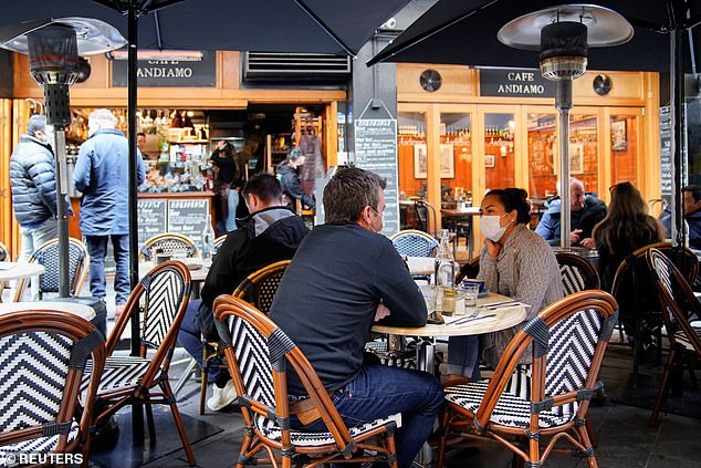 Diners wear protective face masks at a Melbourne café (pictured) on the first day of eased coronavirus restrictions back in June before the latest outbreak began