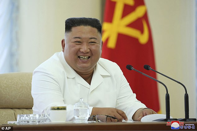 Kim looking much bigger in his white jacket at a meeting in June, 2020