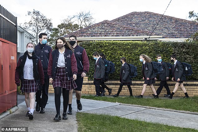 Year 12 students in Victoria are expected to return to the classroom as part of the new strategy. (pictured, Bentleigh Secondary College students as restrictions eased following an earlier outbreak in July)