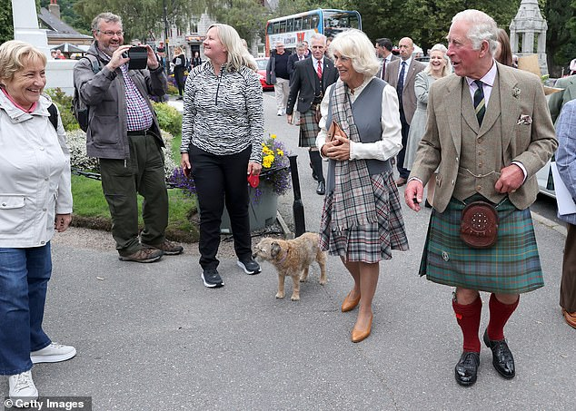 A little dog also caught the eye of the Duke and Duchess of Cornwall as they walked through the Aberdeenshire village
