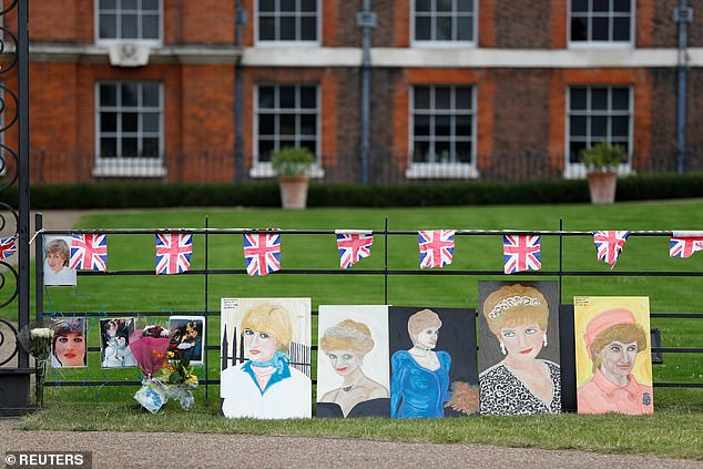 Fans of the late royal show off their artwork, leaving colourful canvases depicting the princess resting along the fence at Kensington Palace