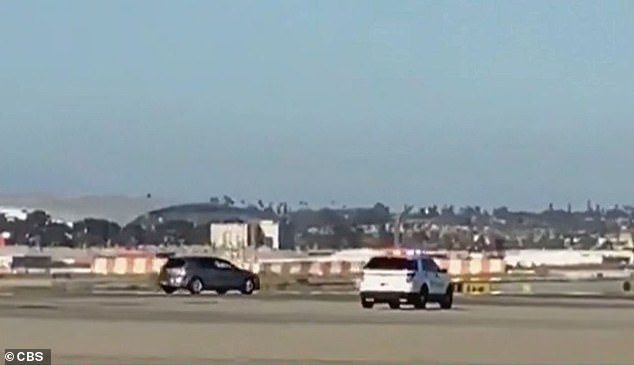 The driver was spotted crashing past a gate onto the airfield