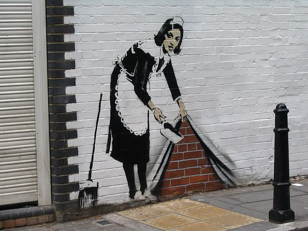 Experts have warned that the rapidly expanding NFT marketplace is being increasingly exploited by scammers. Pictured: Banksy artwork at Hoxton Square, London
