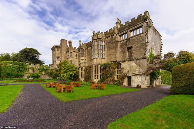The castle has 'ornate oriel windows, gurning gargoyles, and soaring red-brick chimneys', Kate observes