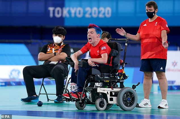 Smith roars with delight after a successful throw during the gold-medal match in Tokyo