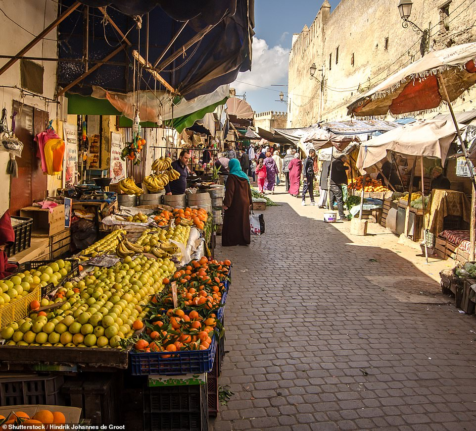 'The dense warren of Fez Medina [pictured] is like stepping back in time – no cars, just donkeys and shopkeepers carting around their goods,' writes Ali