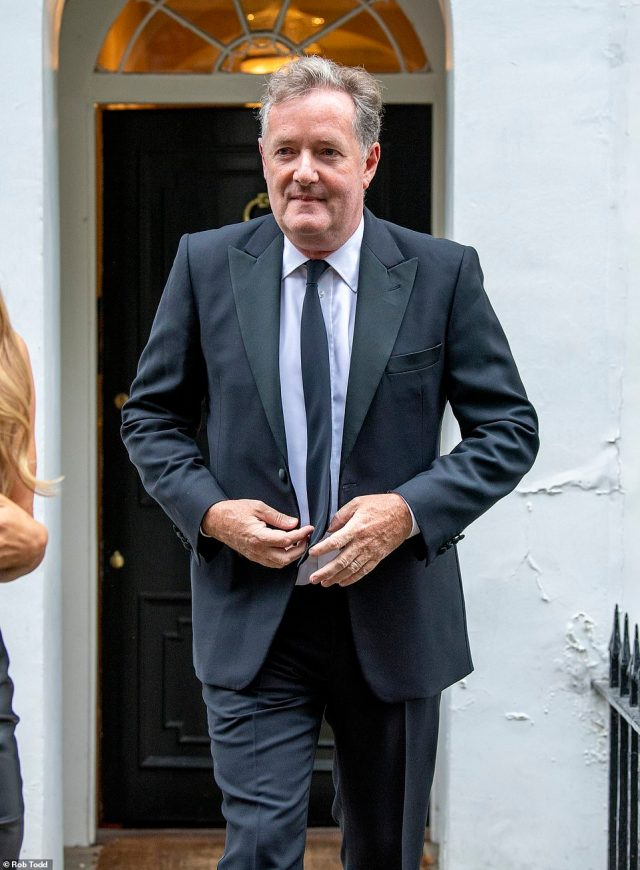 Piers Morgan leaves home in West London on Wednesday evening with wife Celia to attend the GQ awards at Tate Modern