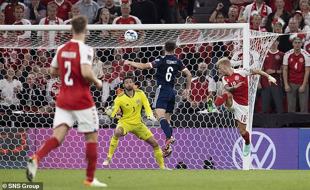 Daniel Wass jumped above Kieran Tierney to head in the opening goal in the 14th minute