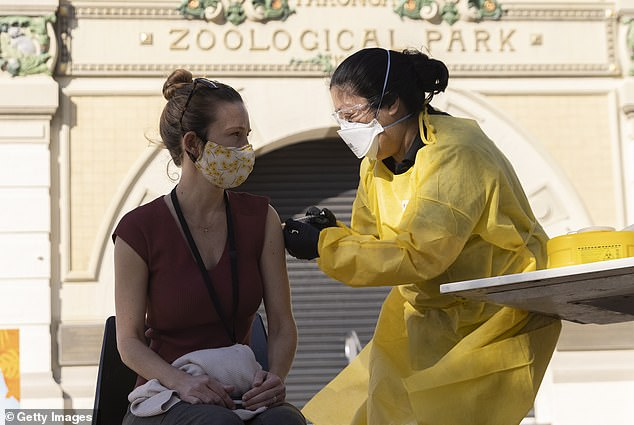 Pharmacist Christine Kelly administers a dose of the AstraZeneca vaccine to Megan English at Taronga Zoo on September 1 in Sydney