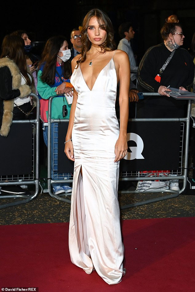 Silver siren! Hana Cross put on a glamorous display in a classic silver gown with a plunging neckline