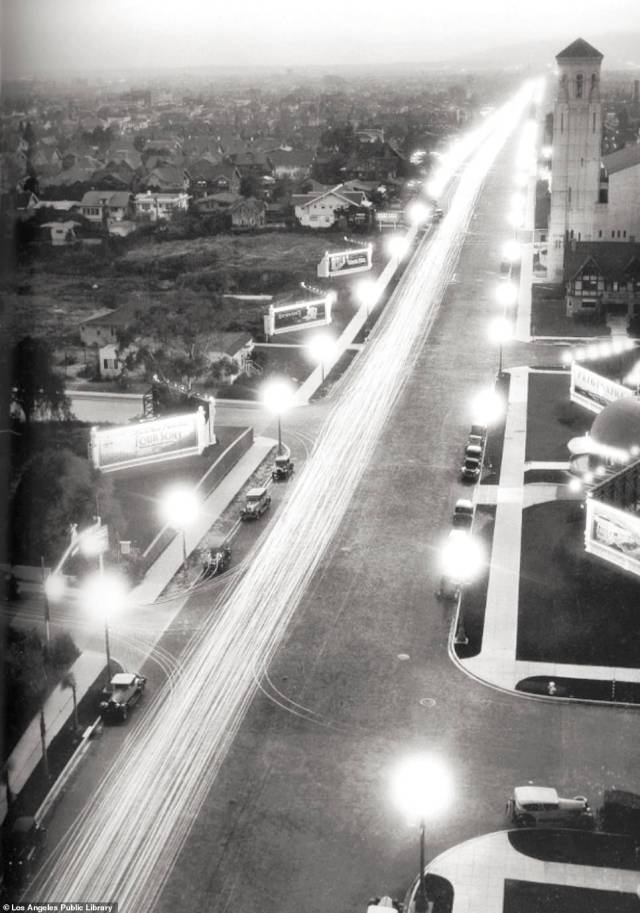 WILSHIRE BOULEVARD: Cast your eye upwards and you'll find a 1928 photograph of Wilshire Boulevard. The road was named after Henry Gaylord Wilshire who, the book reveals, laid the foundations for the street by clearing out a path in his barley field in the 1890s. Eventually, the road stretched out 16 miles and connected five of the city's major business districts with Beverley Hills and Santa Monica. 'Wilshire Boulevard is lined with buildings representing virtually every major architectural style of the twentieth century,' Rosemary writes. In the archival picture, billboards can be seen advertising movies. To the right of the shot, a sliver of the Brown Derby restaurant and the Wilshire Boulevard Church are visible