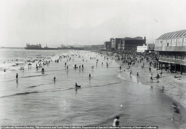 VIEW OF SANTA MONICA BEACH: Taken in 1920, this snapshot shows the popular seaside resort town of Santa Monica. Rosemary explains ornate bathhouses were built near the shoreline for changing into swimming costumes, and visitors competed in 'bathing-beauty' contests on the beach. 'Movie stars and the wealthy built summer homes here,' the author says. However, by the 1970s, the remaining bathhouses had been torn down