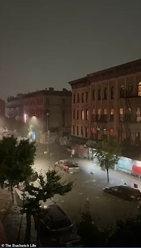 BROOKLYN, NEW YORK CITY: A street in the Bushwick neighborhood is pictured completely flooded on Wednesday