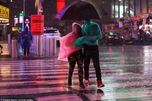 MANHATTAN, NEW YORK CITY: People are seen walking at Times Square as Ida brought mass flooding and damage