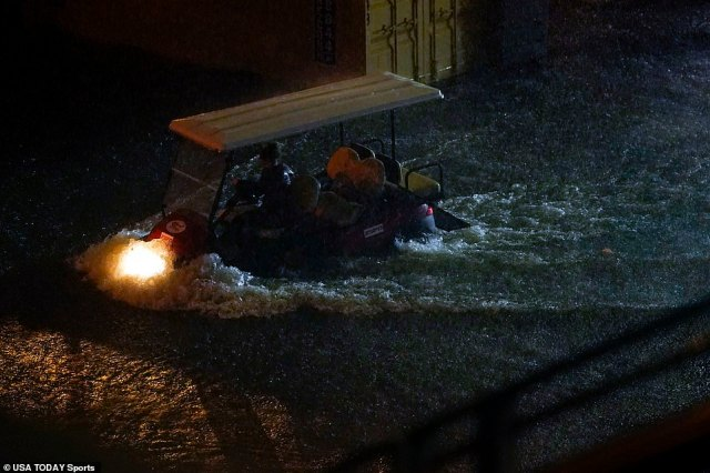 FLUSHING, NEW YORK: A golf cart drives through flood water outside Louis Armstrong Stadium on day three of the U.S. Open