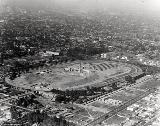 LOS ANGELES COLISEUM: If you look above, you'll see the Los Angeles Coliseum as it appeared in 1923. It had been commissioned two years earlier to honor veterans of World War I, the author reveals. Costing just under $1million to build, it originally held a seating capacity of 75,144. The very first sporting event to play out on the field was a football game between Pomana College and the University of Southern California – the latter won with a score of 23-7. Rosemary says: 'By 1930 Los Angeles had emerged on to the world stage and earned the honor of hosting the 1932 Olympic Games. The city scrambled to accommodate everyone, expanding the Coliseum's seating to 101,574.' More than half a century later, the stadium did it again and successfully hosted the 1984 Olympics