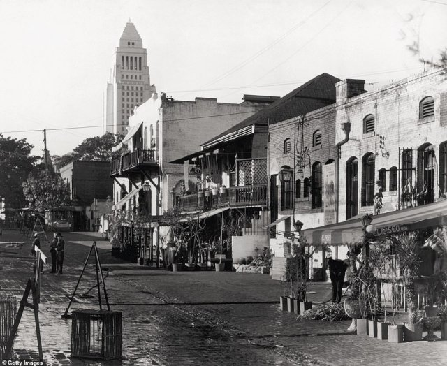 OLVERA STREET: The photo shows Olvera Street -considered to be the oldest street in Los Angeles - in 1940. It was originally a lane known as Wine Street but according to Rosemary it was renamed in 1877 'in honor of one of its residents, Agustin Olvera, the county's first judge'. Sadly,  by the time the 1920s rolled around, the street had fallen into disrepair. The author explains: 'In 1926 civic leader Christine Sterling, shocked to find it now a slum, began a campaign to renovate the street, enlisting her wealthy friends to save this historic heart of Los Angeles.' The street was later paved in bricks by a local prison gang. In 1930, Olvera Street reopened as a Mexican marketplace and hoards of tourists soon showed up