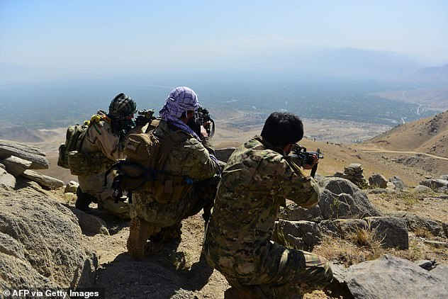 Resistance fighters in the Panjshir Valley on Wednesday scope out the roads below as the defend their homeland from the Taliban