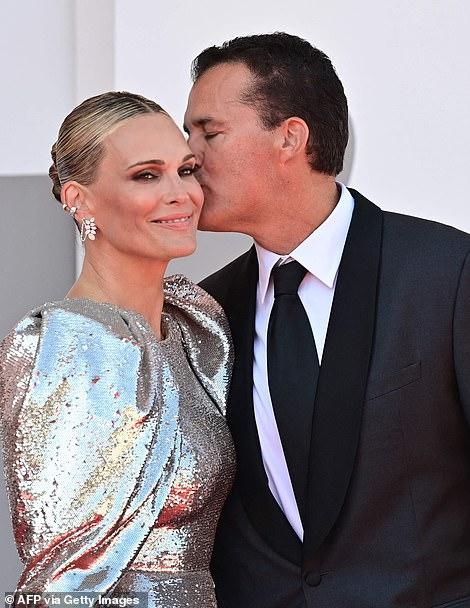 Kiss: Scott planted a kiss on his wife's cheek