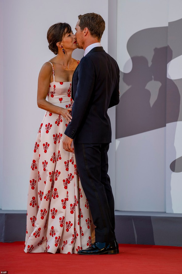 Sweet: Benedict planted a kiss on his wife's cheek as onlookers watched on