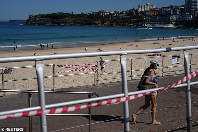 Ms Berejiklian has flagged the only way out of NSW's gruelling lockdown is by hitting the national cabinet's vaccinations target of 70 per cent (pictured, Bondi Beach in Sydney on Thursday)