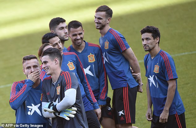 Saul Niguez and Kepa (bottom left) are pictured together with the Spanish national team