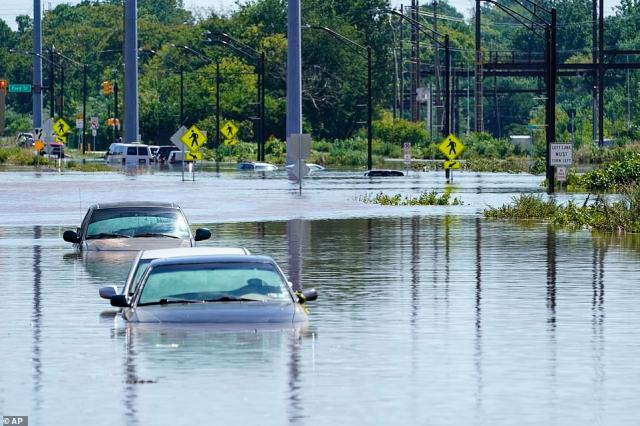 Vehicles are under water during flooding in Norristown, Pennsylvania, on Thursday, Sept. 2, 2021