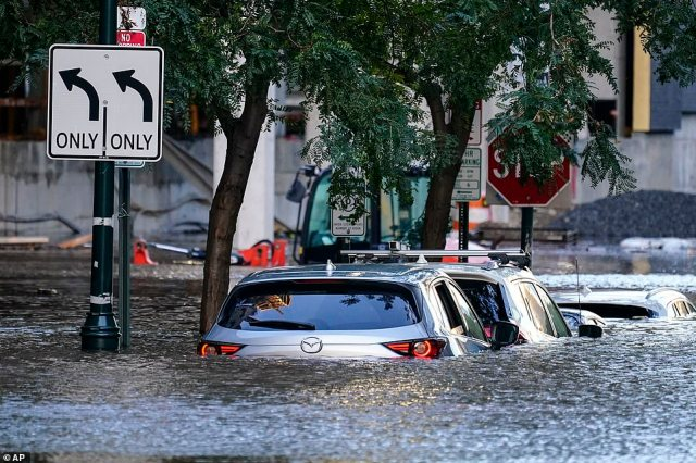 Vehicles are under water during flooding in Philadelphia, Thursday, Sept. 2, 2021 in the aftermath of downpours and high winds from the remnants of Hurricane Ida
