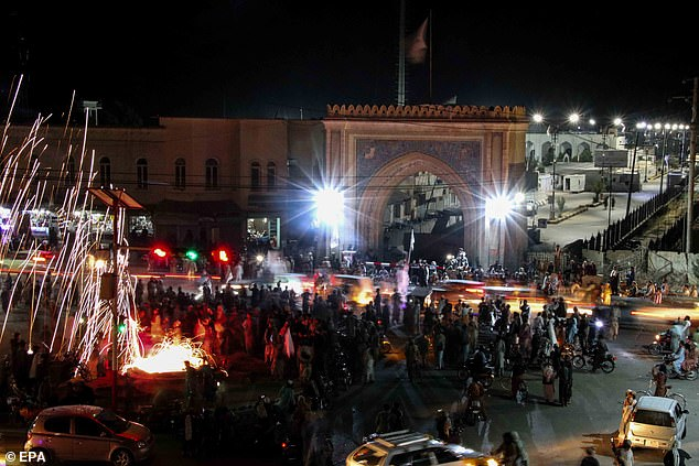 Joe Biden has faced increasing criticism over the pullout of American troops. Pictured: People celebrate the withdrawal of US forces in Kandahar, Afghanistan on September 1