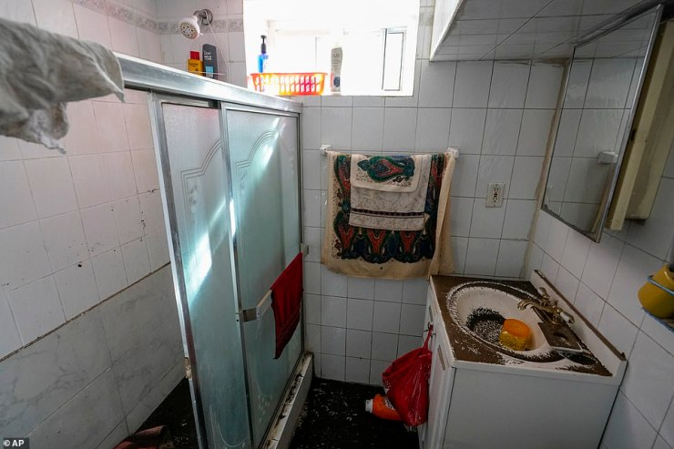 Felix Delapuente's basement bathroom was left covered in dirt and grim after water was finally drained from the premises Thursday