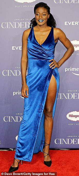 Centre of attention:Basketball player Temi Fagbenle flashed her toned legs in a slitted blue gown, which she matched to the colour of her lipstick