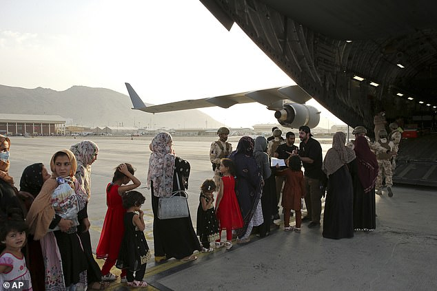The first death of an Afghan evacuee was recorded on Wednesday in Philadelphia. Evacuees are pictured boarding a military planeat Hamid Karzai Airport in Kabul last month