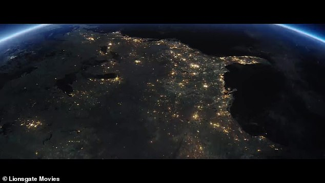 Lights out:The lights continue to go out across North America as JFK continues his speech, stating, 'Why, 35 years ago, fly the Atlantic?