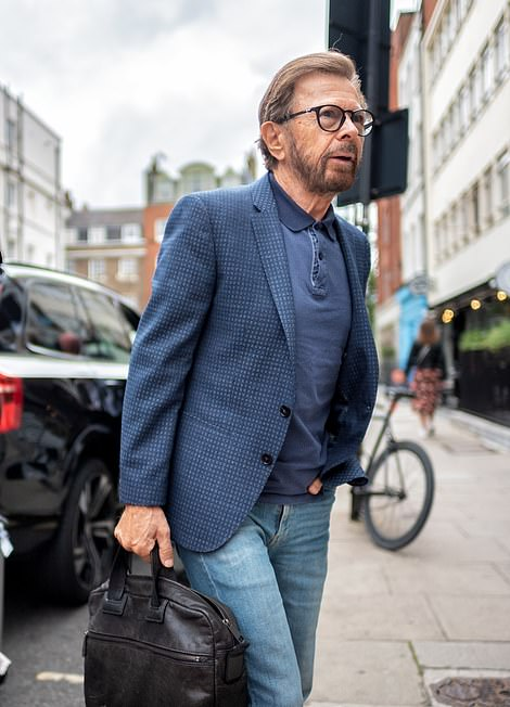 Touched down: ABBA's Björn Ulvaeus was seen arriving in London on Thursday ahead of making a 'historic' announcement regarding the band