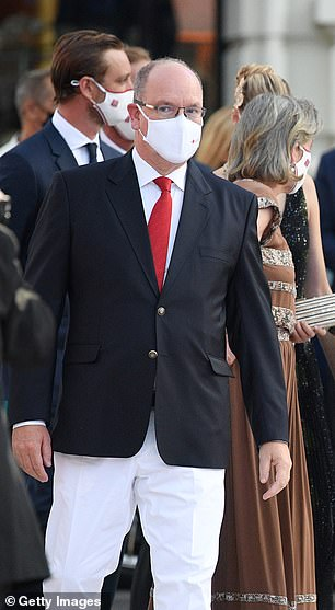 Prince Albert of Monaco is facing growing calls to reveal whether his marriage to Princess Charlene is on the rocks after he attended a ball alongside his former mistress and their love child during his wife's extended stay in South Africa (pictured, Prince Albert at the Red Cross Ball in July 2021)