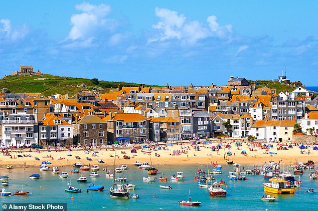 Communities Secretary Robert Jenrick is planning a range of reforms that will give councils powers to ban the creation of new second homes. Pictured: St Ives Bay in Cornwall