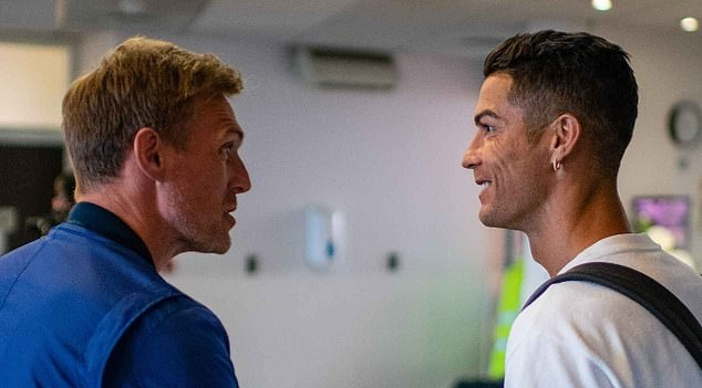 He was welcomed by former team-mate and United technical director Darren Fletcher (left)
