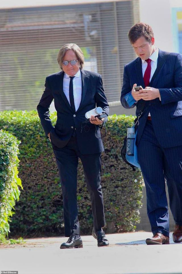 Hadid, seen above outside of the Santa Monica Courthouse on August 30, says legal troubles and losses from the Bel Air property have forced him to downsize to a more 'modest home'