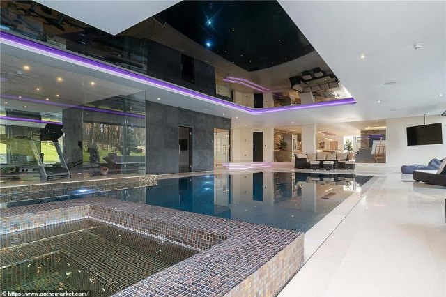Photographs from inside the mansion reveal a swimming pool, gym and cinema room which Ronaldo will be able to enjoy with his young family ahead of the start of training next week