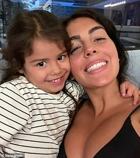 Ms Rodriguez is pictured with her child