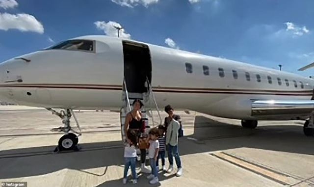 Cristiano Ronaldo, widely considered one of the best forwards in the world, will be playing at Old Trafford again after his £19.8million transfer from the Italian giants was finalised on transfer deadline day. Pictured, his girlfriend Georgina Rodriguez and children outside a private jet that took them to the UK