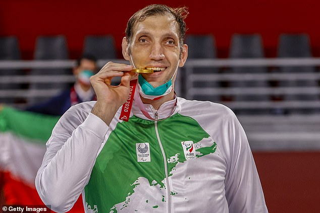 The 8ft1 star (above) is the second-tallest man in the world and the tallest Paralympian ever