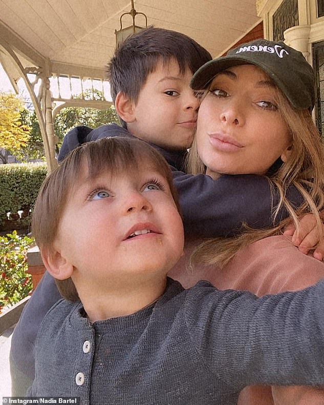 Family: Nadia and Jimmy are co-parents to two sons: Ashton, five, and Henley, two (pictured)
