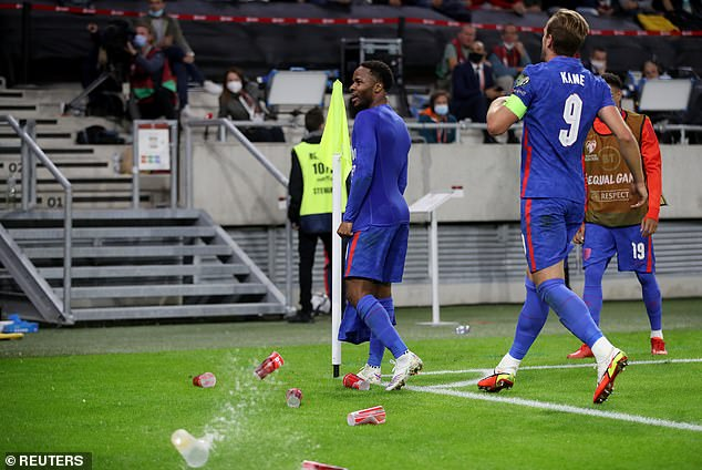 England's stars were pelted with beer cups and other objects as they celebrated their goals