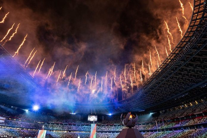 Fireworks go off around the the Olympic Stadium, lighting up the sky to signal the end of the Games for another four years