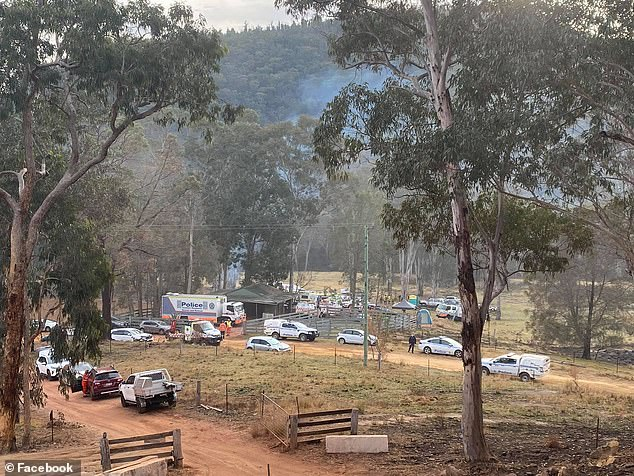 The search continued on Monday with helicopters and drones searching from the air (pictured, rescue crews with police at the property on Sunday)