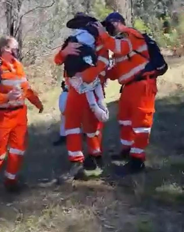 PolAir guided SES volunteers (pictured) on the ground to AJ's location before they carried him to an ambulance