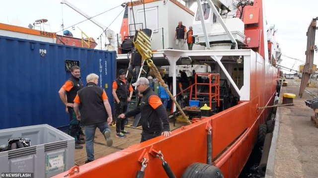 Members of the Baltictech diving group are now beginning their search of the shipwreck, cracking open containers and exploring the site for the lost loot